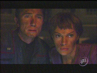Mal and T'Pol staring in shock